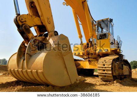 Huge excavator on a sunny day with blue sky - stock photo