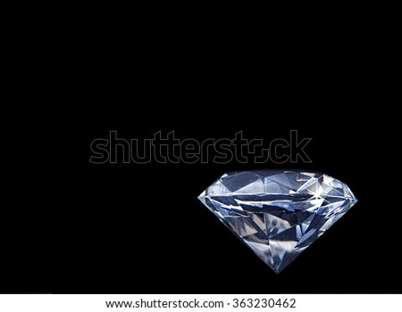 Huge Faux Diamond on black background. Normal position with point downwards.