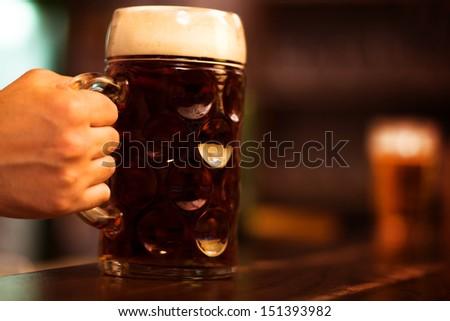 Huge glass of beer - stock photo