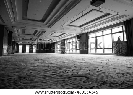 Huge Hall interior with carpet and ceiling with lights in Hotel