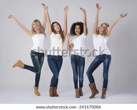 Huge happiness of multi ethnic women   - stock photo