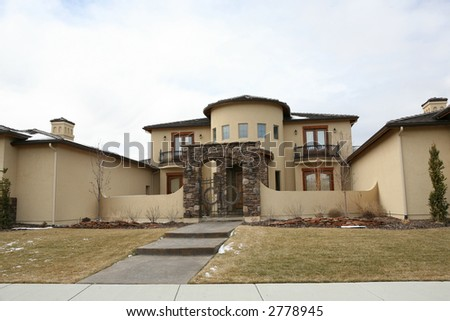 Huge house with gates - stock photo