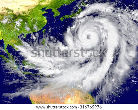Huge hurricane north of Australia. Elements of this image furnished by NASA - stock photo