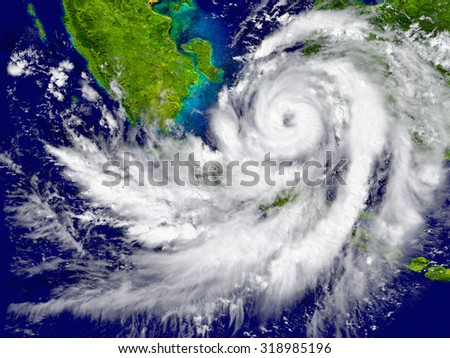 Huge hurricane over Southeast Asia. Elements of this image furnished by NASA - stock photo