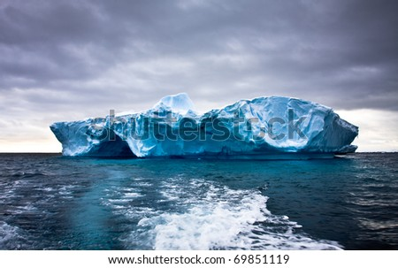 Huge iceberg in Antarctica, beautiful winter background - stock photo