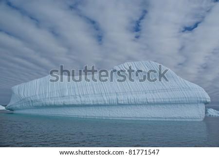 Huge iceberg in sea near Antarctica - stock photo