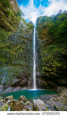 huge impressive waterfall in the end of Levada Caldeirao Verde, Madeira, Portugal - stock photo