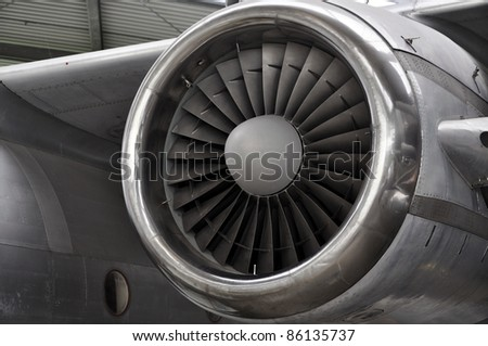 Huge Jet engine on an old plane - stock photo