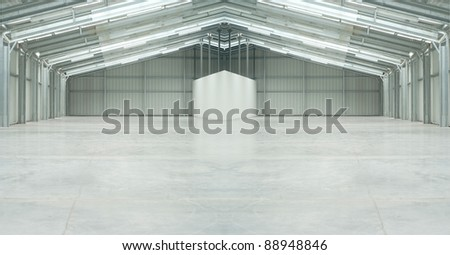 Huge light warehouse in gray with strange form - stock photo