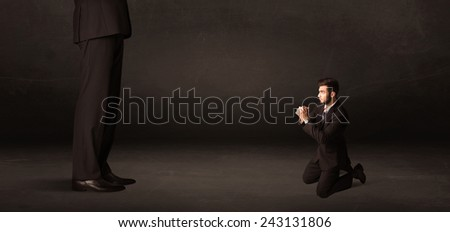 Huge man with small businessman standing at front concept on background - stock photo
