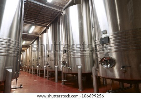 huge metal reservoirs for the fermentation of wine - stock photo
