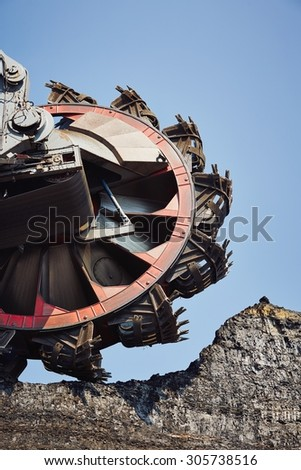 Huge mining machine in the coal mine - stock photo