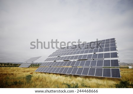 huge photovoltaic panel with blue sky, Zaragoza province, Aragon, Spain - stock photo