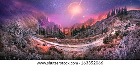 Huge picturesque loop of the old rural road goes around the Carpathian mountain pass, hitting the viewer views frosty slopes of the Alps Ukrainian - stock photo