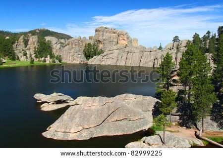 Huge rocks in beautiful Sylvan Lake of Custer State Park in South Dakota - stock photo