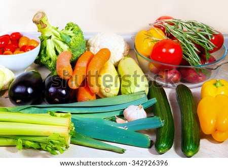 Huge set of fresh vegetables on the kitchen table, waiting to be prepared for the dinner. - stock photo