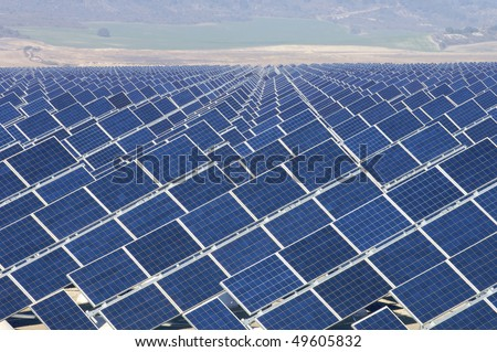 huge solar field with the background fields - stock photo