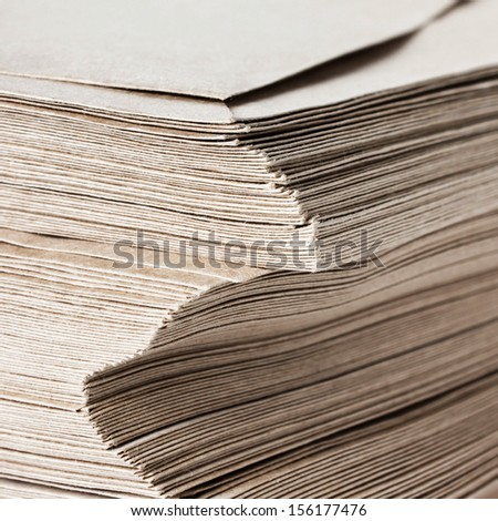 Huge Stack of Recycled Paper envelopes  closeup. Business concept. - stock photo