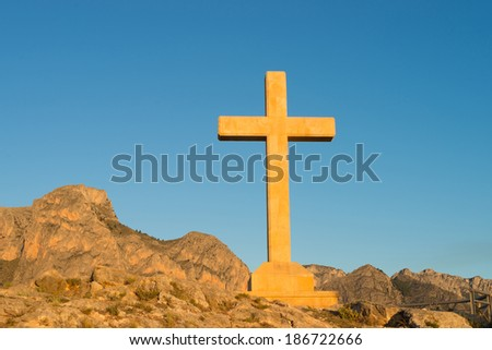 Huge stone cross in a landmark location on a hilltop - stock photo