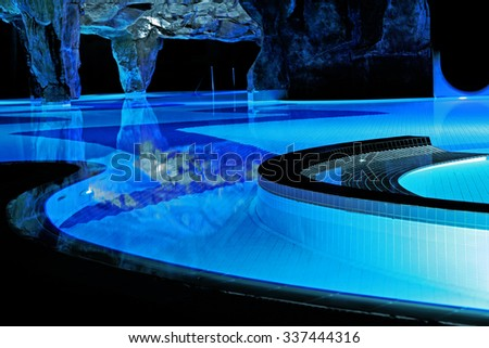 Huge swimming pool in neon light.