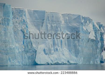 Huge tabular iceberg in antarctica - stock photo