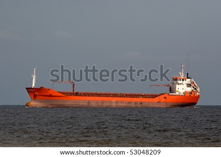 Huge tanker ship sails in open water of a sea or ocean - stock photo