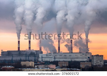 Huge Thermal Power plant with smoking chimneys - stock photo