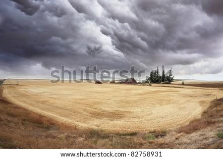 Huge thundercloud on fields of Montana - stock photo