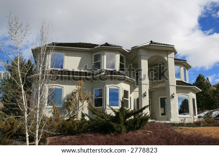 Huge two story modern house on a hill - stock photo