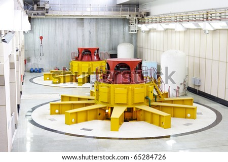 Huge water turbine generators. Hydroelectric power-plant. Interior - stock photo