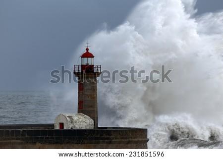 Huge wave against Porto old lighthouse - stock photo