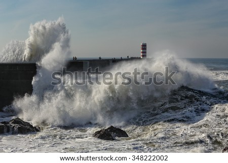 Huge wave rising through the new pier at the mouth of the Douro river, a good but dangerous fishing point