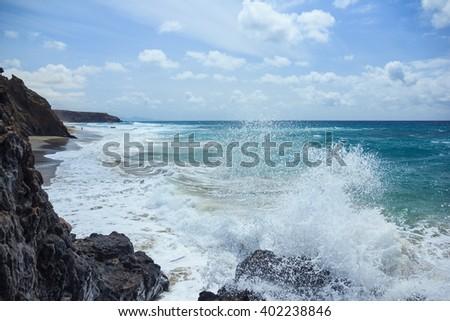 Huge waves crashing on the rocks  shore, in La Pared, Fuerteventura island, Spain. - stock photo