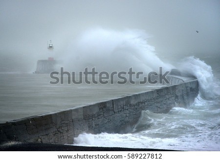 Huge waves striking Newhaven breakwater, UK, during a winter storm