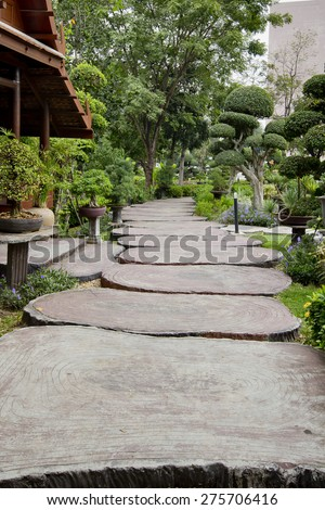 Huge wood path in the garden. The path in the garden. - stock photo