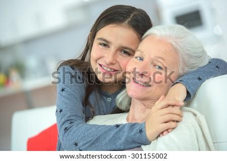 Hugging her grandma - stock photo