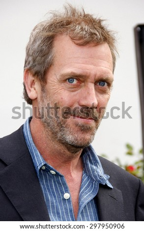 Hugh Laurie at the Los Angeles premiere of 'Hop' held at the Universal Studios Hollywood in Universal City on March 27, 2011.  - stock photo