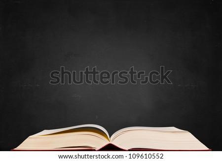 Hugh text book on blackboard background - stock photo