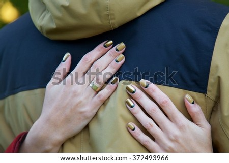 Hugs and golden manicure