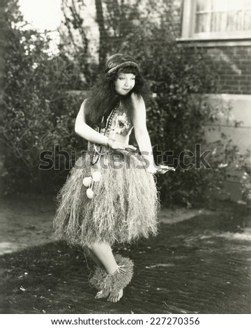 Hula dancing in the backyard - stock photo