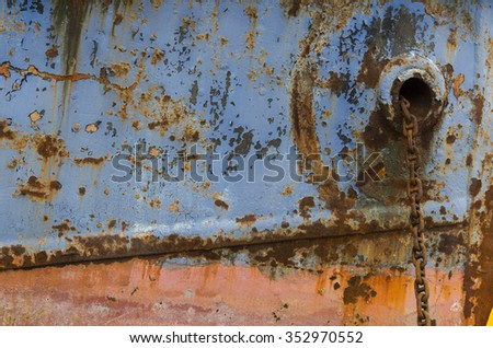 hull of a old boat with rusty anchor chain - stock photo