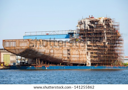 hull of the ship and scaffolding - stock photo