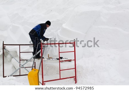 HULL, QUEBEC - FEBRUARY 3: Unidentified sculptor working at Jacques Cartier Park on one of the many giant snow sculptures of the Winterlude Festival, on opening day, February 3, 2012, Hull, Quebec.