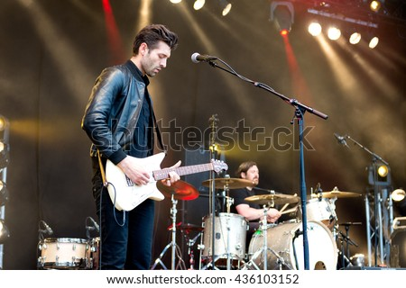 Hulst, the Netherlands - June 3, 2016: Andrew Smith and Piers Hewitt of US indie rock band The Boxer Rebellion perform live on stage at Vestrock festival.