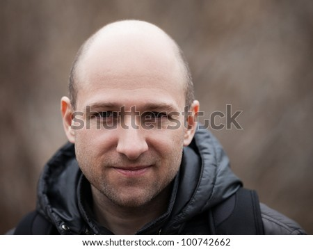 Human alopecia or hair loss - smiling adult man bald head - stock photo