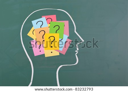 Human brain and colorful question mark  draw on blackboard - stock photo