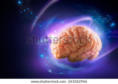 Human brain floating on a blue background / thoughts concept - stock photo
