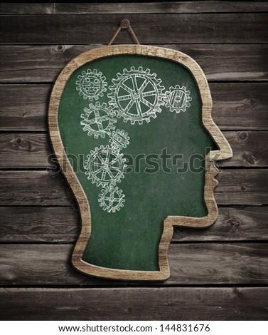 Human brain work drawn by chalk on blackboard - stock photo