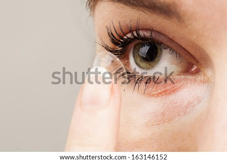 human eye and contact lens - stock photo