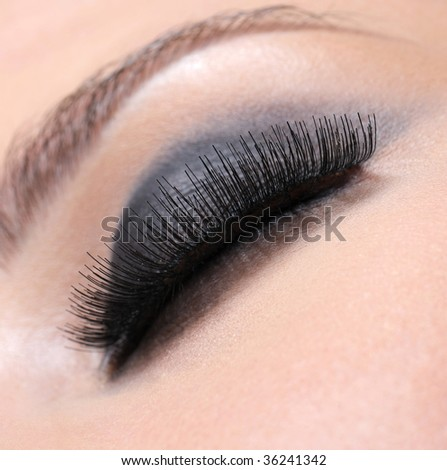 Human eye with volume luxuriant eyelashes - macro shot - stock photo